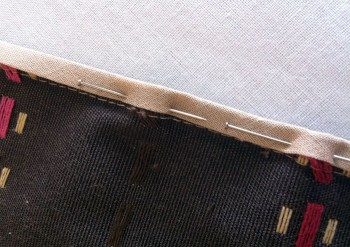 Fold on the centre of the binding