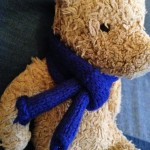 Knitting a scarf for a Teddy