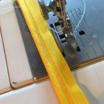 Piped pincushion- stitch piping cord into bias binding