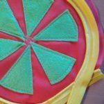 Piped pincushion-stitch decorative felt